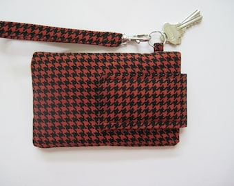 "Fall Houndstooth Smartphone Wristlet,  Fits iPhone 5, Se, and Smartphones up to 5.25"" x 2.75"", Black and Orange Houndstooth Cotton, Key Ring"