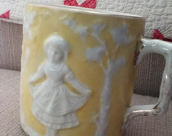 Antique yellow porcelain mug, children dancing, pretty!