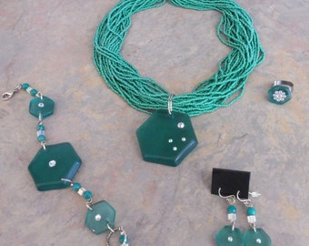 This teal re-purposed teal  glass necklace rocks!   Embellished with Swarovski crystals and strung on thousands of tuquoise seed beads!