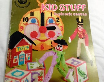 Kid Stuff In Plastic Canvas Booklet By Boye/Needle Craft/Plus 2 New 7 Mesh Plastic Canvas Included/Book In Great Condition (X)