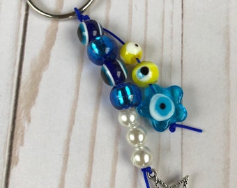 Key chain with blue and yellow evil eye murano glass / Mprelok me mataki mple k kitrino