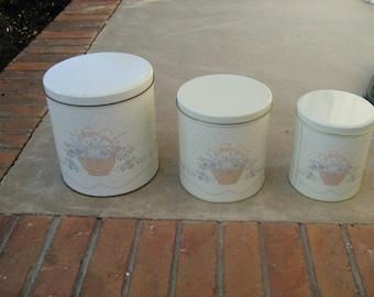 Vintage 3 piece metal flowers and basket canister set