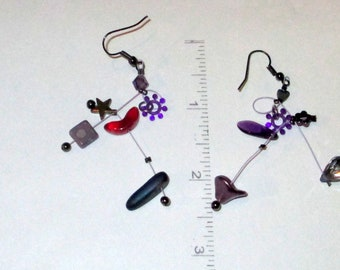Lila, unmatched, purple mobiles,  sculptural, geometric,textured,steampunk,   contemporary, handmade