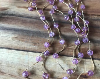 "Vintage hand beaded purple necklace. 84"" long."