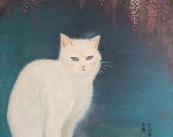 A White Cat Under Purple Bloosom