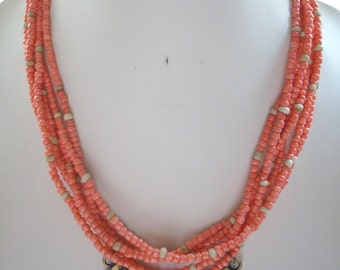 Multi Strand Coral and Indonesia Cream Raw Glass Bead Necklace with Large Antique Brass Connector Bib Pendant
