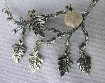 Frost flower: unique repurposed upcycled vintage silver tone branch with dangling leaves and vintage flower bead assemblage bib necklace