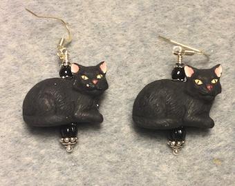 Black ceramic cat bead earrings adorned with black Czech glass beads.