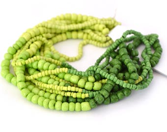 Assortment of beads green size 1.5 mm to 4 mm