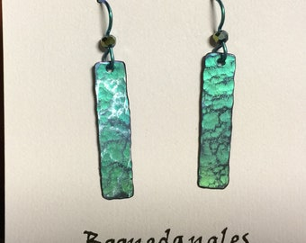 Titanium drop earrings.  Anodized green with blue highlights.  On hypoallergenic Niobium (Nb) earwires.