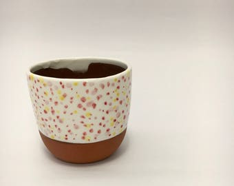 Colourful sprinkled cup
