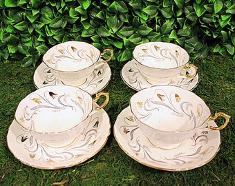Paragon Silver and Gold Teacup Set