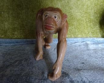 Pot Melba ware monkey in stride