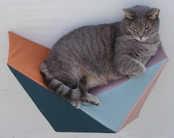 Cat shelf wall bed in teal, rust, seafoam, mauve and apricot