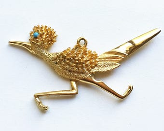 eco friendly vintage large gold tone metal roadrunner bird pendant with 3D feathers and turquoise blue rhinestone eye