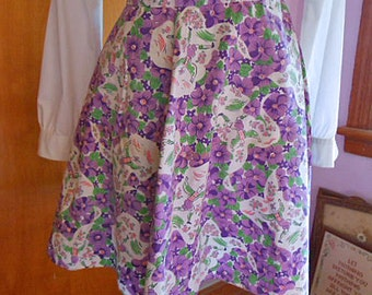 SPRING VIOLETS APRON Dancing Man Purple Flowers Green Leaves Orange Daisies Clouds, Flared Cotton Half Skirt, 1950s Handmade Kitchen Unused