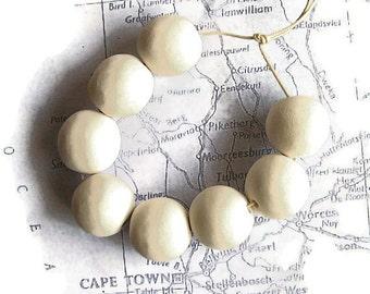 Unglazed white earthenware ceramic beads, bisque beads, handmade ceramic bisque beads, white beads, matte white beads, matte beads, African