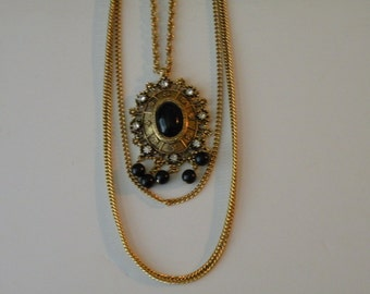 Celebrity Gems triple strand black plastic rhinestone necklace.