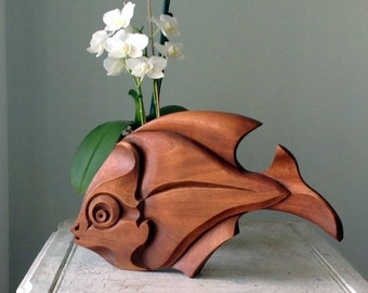 """Unique wooden sculptures, inspired by the """"yin and yang"""""""