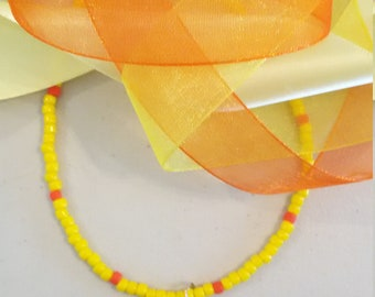 Little yellow ducky necklace lamp worked glass duck on a strand of yellow and orange glass seed beads.