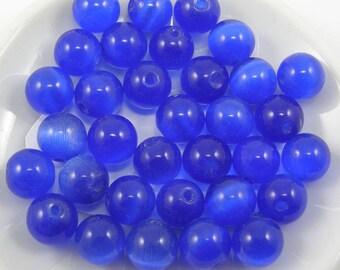 Set of 5 8 mm dark blue cat eye glass beads