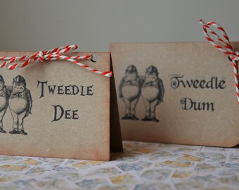 10 freestanding Alice in Wonderland themed wedding table place cards sittings