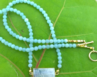 "Beach Dreams: Faceted Blue-Green Amazonite is paired with a Pendant of dreamy Rainbow Moonstone; ""Hope Stone"""