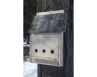 White Birdhouse with Metal Roof