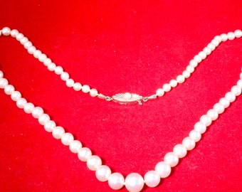 Pearl necklace w. progression