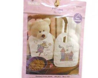 Bucilla Cross Stitch Baby Bib Kit | Set of Two Pre-Finished Bibs to Cross Stitch | Stamped X-stitch Princess Bib Kit |
