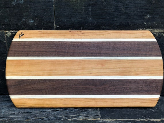 Cutting board made ftom walnut, cherry and maple woods