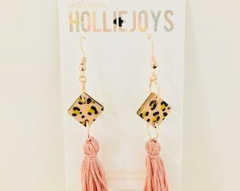 Leopard print dangle earrings.