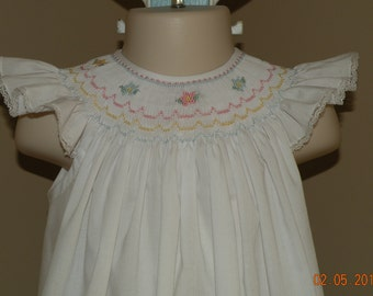 White Bishop Style Dress with Smocked flowers