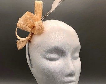 Cream loop sinamay fascinator with matching feathers. Handmade in the UK