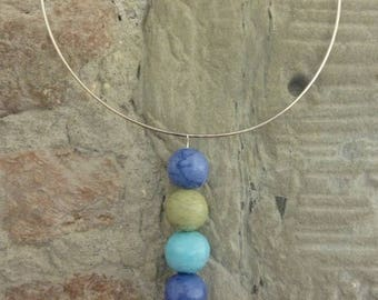 Pendant four balls of Cotillion blue and green. Recycled jewelry. Upcycling. Recovery. Recycling.