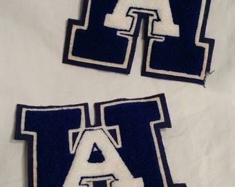 Pair of vintage  H A varsity letters, blue