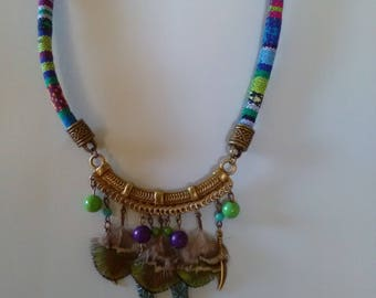 Ethnic necklace, peacock feathers and beads