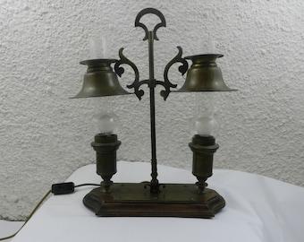 Bronze lamp on wooden base
