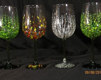 Beautiful 4 Seasons hand painted  20 oz olive stemmed wine glasses.