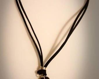 Black heart pendant.