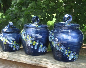 kitchen canisters, navy with yellow, white, turquoise crystals