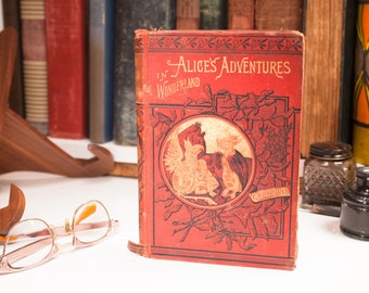 1884, Alice's Adventures in Wonderland by Lewis Carroll. MacMillan & Co. New Edition. Forty-Two Illustrations by John Tensile. Antique book.