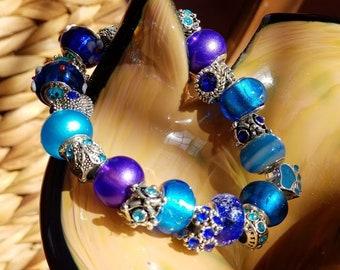 This bracelet is a vibrant and beautiful mix of glass and silver plated beads encompassing blues of the ocean and heavens.