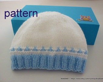 Knitted pattern.Pattern for baby hat .Knitted baby boys hat in white and blue.