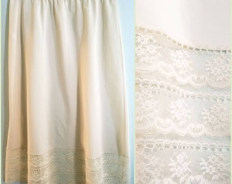 Vintage 70s half slip with scalloped lace hem.