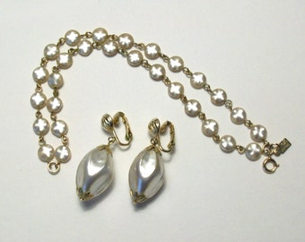 Vintage Emmons bracelet and earrings. Specially pretty design from 1960's. Dual strand faux pearls and gold tone accents.