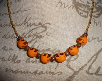 Ochre yellow skull beaded necklace