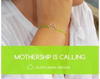 Mothership Is Calling, Friendship silver bracelet