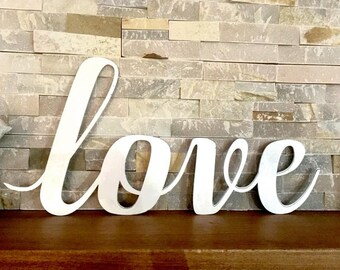 Cursive Love Sign