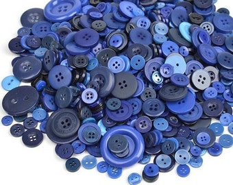 25 buttons in different sizes in shades of blue